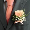 ORANGE ROSE GROOM BUTTONHOLE 2